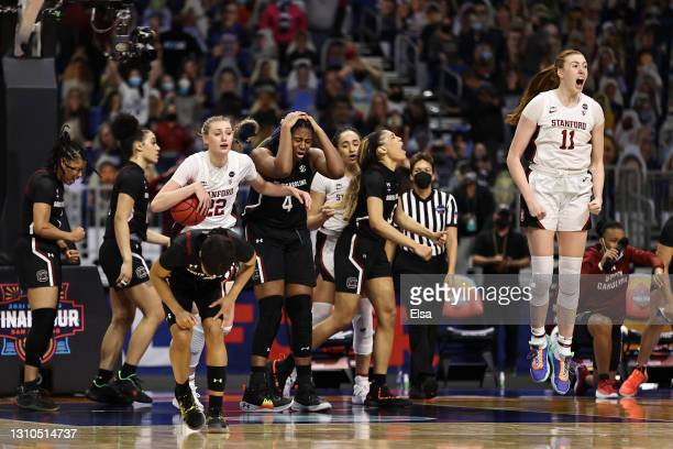 The Stanford Cardinal celebrate after defeating the South Carolina Gamecocks in the Final Four semifinal game of the 2021 NCAA Women's Basketball...