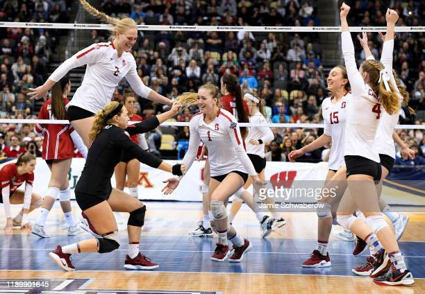 The Stanford Cardinal celebrate after defeating the Wisconsin Badgers during the Division I Women's Volleyball Championship held at PPG Paints Arena...