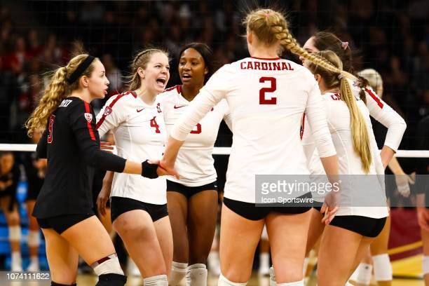 The Stanford Cardinal celebrate after scoring a point in the 3rd set during the match between the Stanford Cardinal and the Nebraska Cornhuskers on...