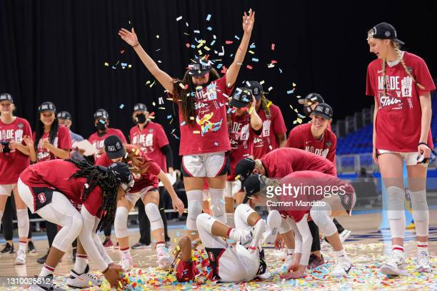 The Stanford Cardinal celebrate their win over the Louisville Cardinals in the Elite Eight round of the NCAA Women's Basketball Tournament at the...