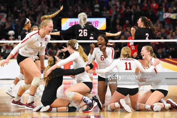 The Stanford Cardinal celebrate winning the Division I Women's Volleyball Championship held at the Target Center on December 15 2018 in Minneapolis...