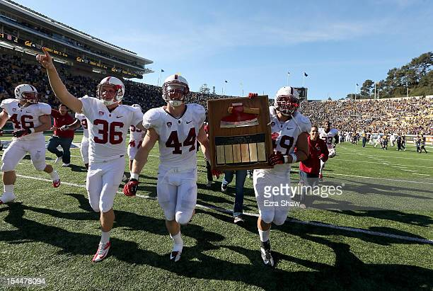 """The Stanford Cardinal celebrate with the Axe after beating the California Golden Bears in the """"Big Game"""" at California Memorial Stadium on October..."""