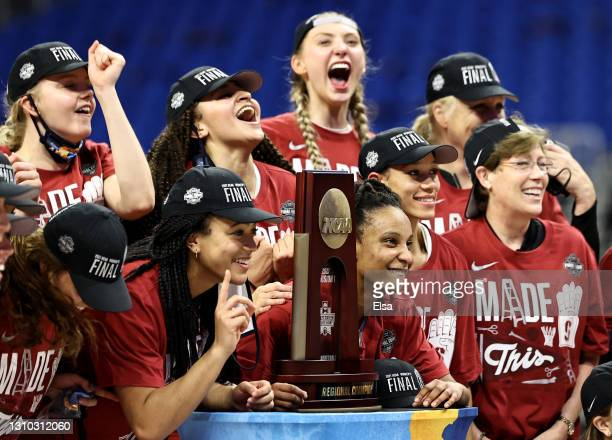 The Stanford Cardinal celebrate with the regional championship trophy after the win over the Louisville Cardinals during the Elite Eight round of the...