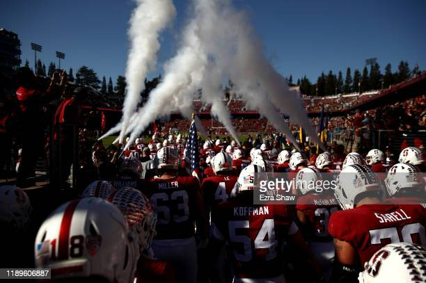 The Stanford Cardinal run on to the field for their game against the California Golden Bears at Stanford Stadium on November 23, 2019 in Palo Alto,...