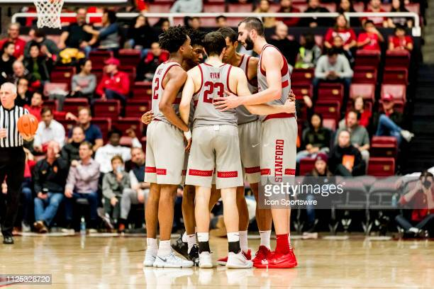 The Stanford Cardinal team huddles during the men's college basketball game between the USC Trojans and Stanford Cardinal on February 13 2019 at...