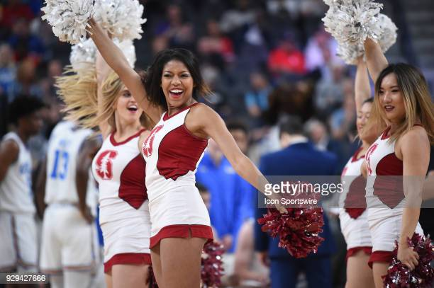 The Stanford cheerleaders perform during the PAC12 Men's Basketball Tournament game between the Stanford Cardinal and the UCLA Bruins on March 08...