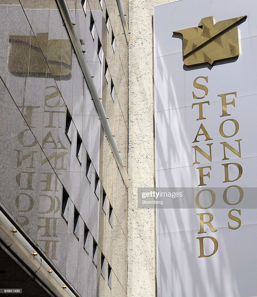 The Stanford Group flag flies outside of their closed office ...