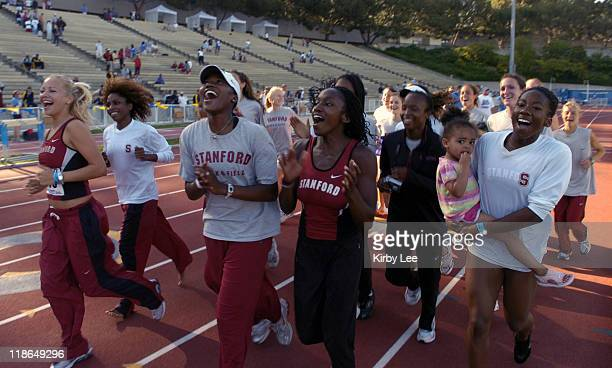 The Stanford women take a victory lap after winning the school's first women's conference track title in the Pacific-10 Conference Track & Field...