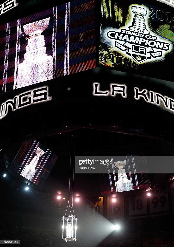 The Stanley Cpu is lowered from the scoreboard during a pre game ceremony before the game between the San Jose Sharks and the Los Angeles Kings at Staples Center on October 8, 2014 in Los Angeles, California.