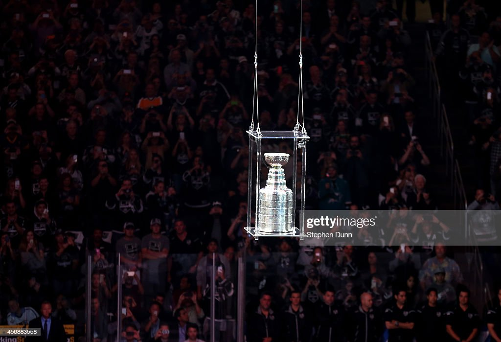 The Stanley Cup is lowered to the ice during ceremonies for the Los Angeles Kings before playing the San Jose Sharks in their NHL season opener at Staples Center on October 8, 2014 in Los Angeles, California.