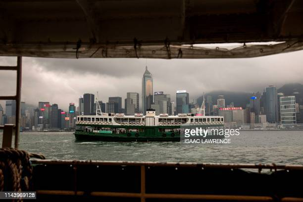 The Star Ferry crosses Victoria Harbour in front of the Hong Kong skyline on May 15 2019