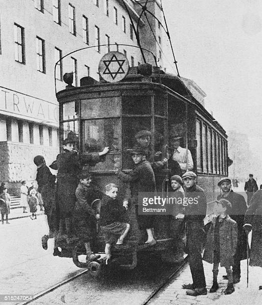 The Star of David attached to the top of this street car indicates it is in use for residents of Warsaw's ghetto wherein live Jews from every Nazi...