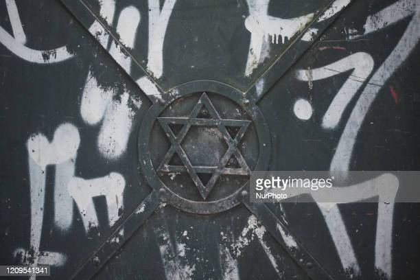 The Star of David seen on iron door in Kazimierz a historic Jewish quarter of Krakow Passover also known as 'Pesach in Hebrew is one of the most...