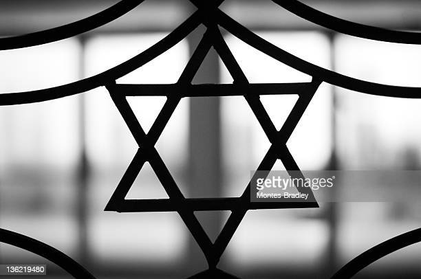 the star of david signifying jewish religion - anti semitism stock pictures, royalty-free photos & images