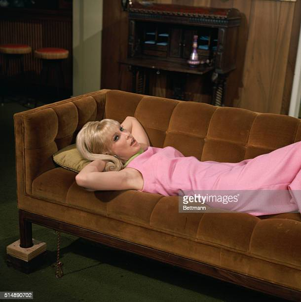 The star of I Dream of Jeanie, Barbara Eden, relaxes on sofa in a scene from the hit television series which ran from 1965-1970.