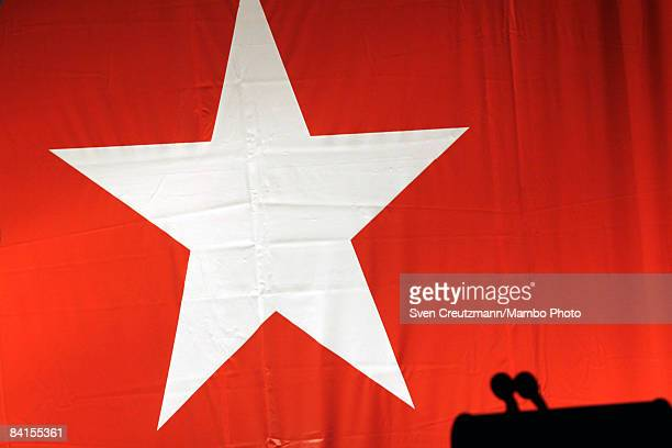 The star of the Cuban flag is displayed behind the podium moments before the celebrations at the city hall where now ailing Revolution leader Fidel...