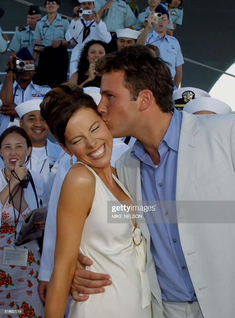 The star of the movie 'Pearl Harbor' Ben Affleck(R) kisses his co-star Kate Beckinsale(L) as US Navy personnel applaud as they arrive for the world premiere of 'Pearl Harbor' which was shown on the deck of the US Navy aircraft carrier USS John C. Stennis 21 May, 2001. Thousands of Navy personnel and guests viewed the premiere which also stars Cuba Gooding Jr. and Josh Hartnett. AFP PHOTO Mike NELSON/mn