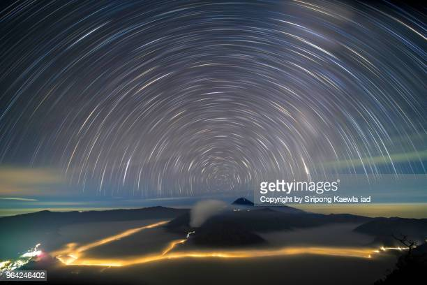 the star trails over the mt.semeru, mt.bromo and mt.batok, east java, indonesia. - mt bromo stock photos and pictures