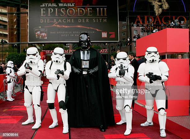 The Star Wars figures Storm Troopers and Darth Vader poses at a cinema for the German premiere of 'Star Wars Episode III Revenge of the Sith' on May...