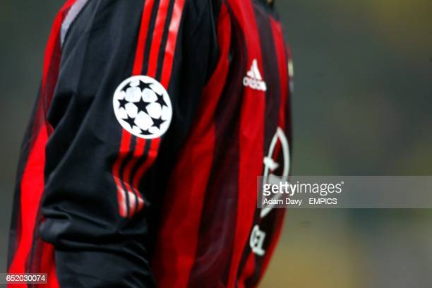 The starball logo on the sleeve of the AC Milan shirt