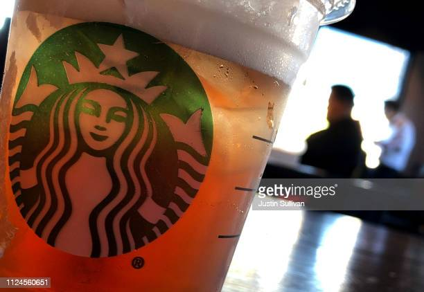 The Starbucks logo is displayed on a cup at a Starbucks Coffee shop on January 24 2019 in San Francisco California Starbucks will report first...