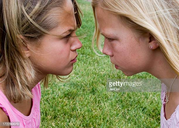 the stare - nasty little girls stock photos and pictures