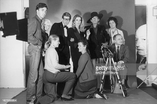 The stars and crew of a photographic shoot to mark the twentieth anniversary of the Yves Saint Laurent fashion house, 16th November 1981. Left to...