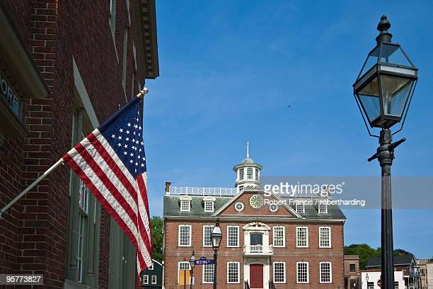 The Stars and Stripes and brick Georgian-style Old Colony House dating from 1741, a National Historic Landmark used in the Steven Spielberg film Amistad, on Washington Square in Newport, Rhode Island, New England, United States of America