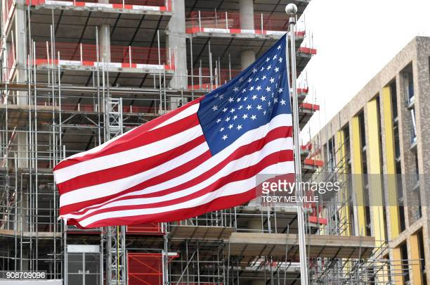 The Stars and Stripes flies outside the new US Embassy in Britain as construction work continues on buildings behind in London on January 22 2018 US...