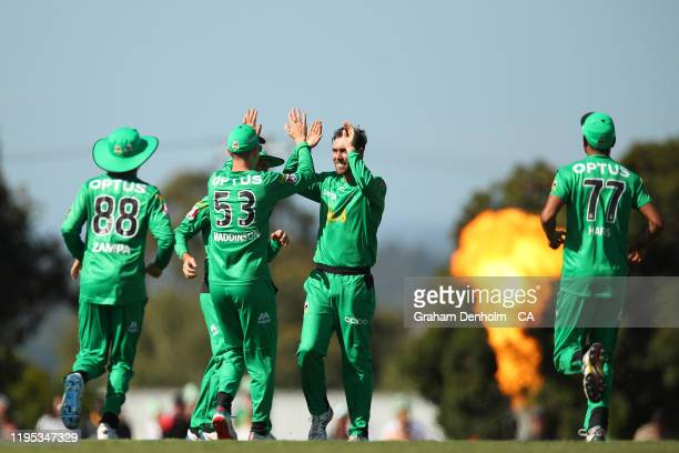 The Stars celebrate the dismissal of David Miller of the Hurricanes during the Big Bash League match between the Melbourne Stars and the Hobart...