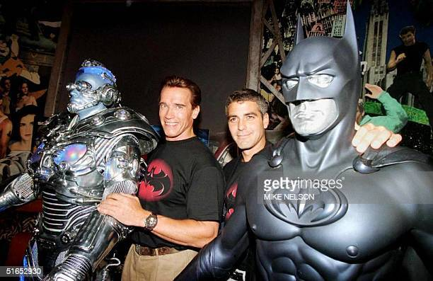 "The stars of ""Batman & Robin,"" actors Arnold Schwarzenegger and George Clooney pose with their costumes, Mr. Freeze and Batman, 06 June at Planet..."