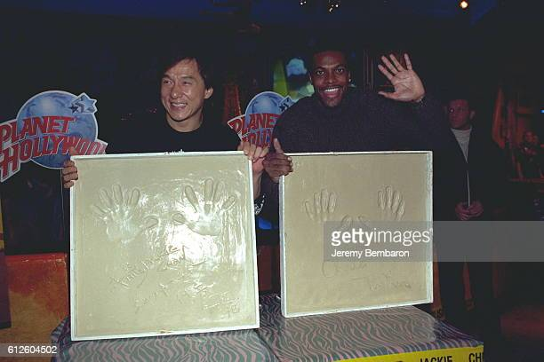 The stars of Brett Ratner's movie Jackie Chan and Chris Tucker leave their hand imprints