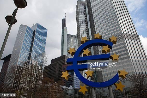 The stars of European Union membership sit on a euro sign sculpture outside the headquarters of the European Central Bank in Frankfurt Germany on...