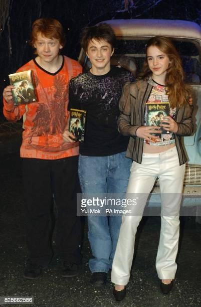 The stars of Harry Potter and the Chamber of Secrets from left to right Rupert Grint Daniel Radcliffe and Emma Watson during the worldwide launch of...