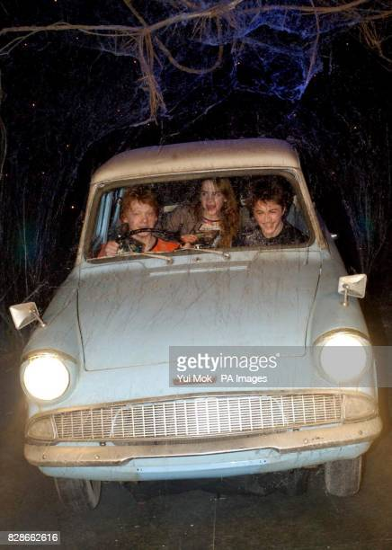 The stars of Harry Potter and the Chamber of Secrets from left to right Rupert Grint Emma Watson and Daniel Radcliffe during the worldwide launch of...