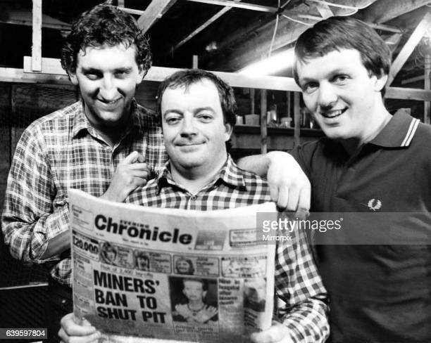 The stars of hit television programme Auf Wiedersehen, Pet - left to right - Jimmy Nail, Tim Healy and Kevin Whatley reading a copy of the Newcastle...