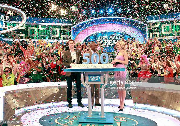 The stars of LET'S Make a Deal Announcer Jonathan Mangum Host Wayne Brady and Model Tiffany Coyne celebrate on stage with confetti on a special 500th...