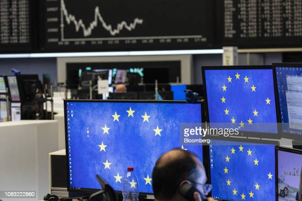 The stars of the European Union sit on a trader's monitors inside the Frankfurt Stock Exchange, operated by Deutsche Boerse AG, in Frankfurt,...
