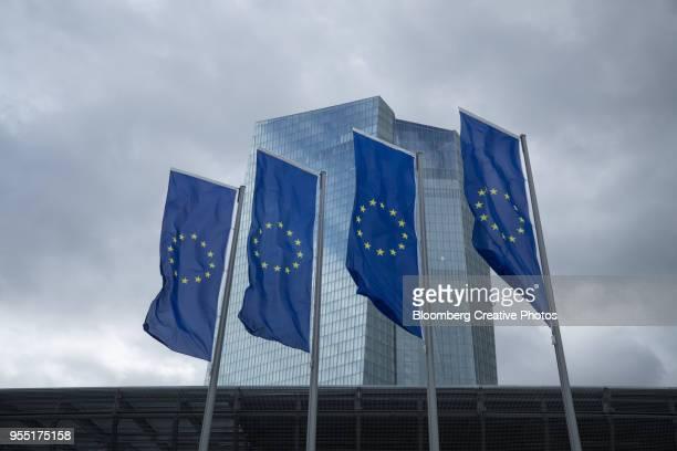 The stars of the European Union (EU) sit on banners flying outside the European Central Bank