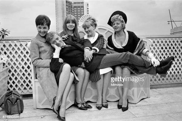 The stars of the film 'Alfie' Vivien Merchant, Jane Asher, Julia Foster and Shelley Winters with Michael Caine laying across them, 4th July 1965.