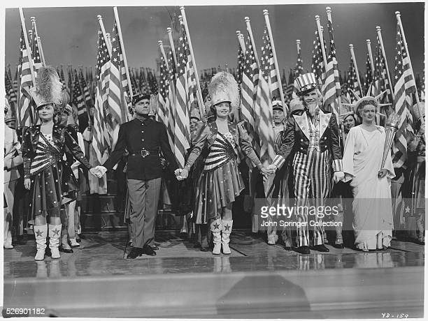 The stars of Yankee Doodle Dandy from left to right Jeanne Cagney James Cagney Joan Leslie Walter Huston Rosemary DeCamp