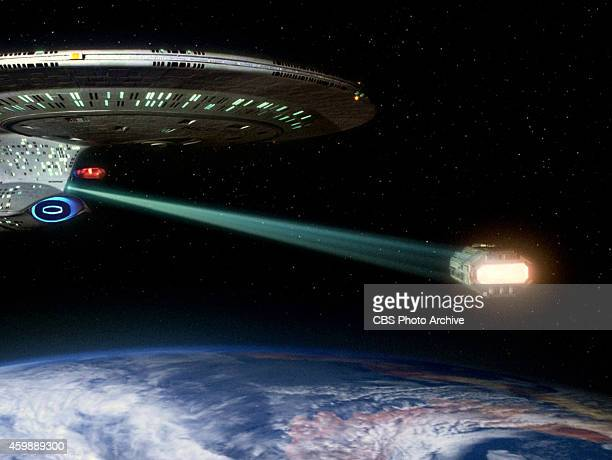 The starship Enterprise using its tractor beam in the STAR TREK THE NEXT GENERATION episode The Hunted Season 3 episode 11 Original air date January...