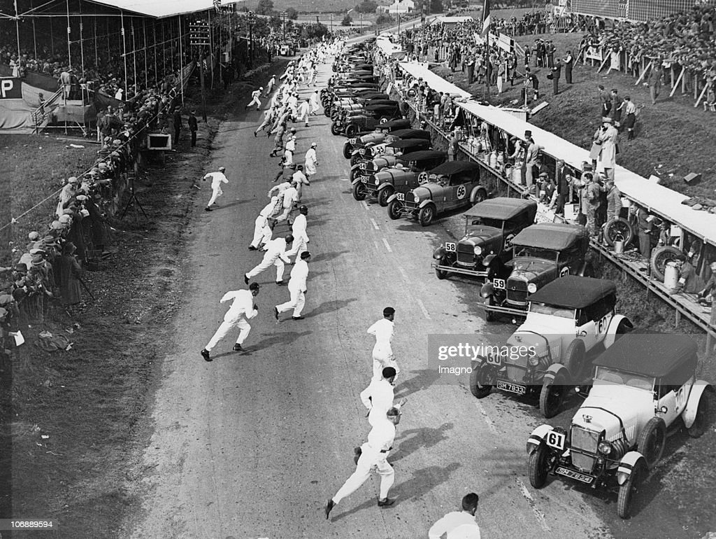 The start of a great race- drivers running to their automobiles. Belfast, Ireland. Photograph. August 19th 1929.