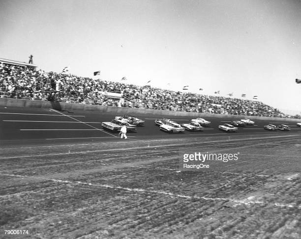 The start of the 1959 Daytona 500 on February 22 1959 in Daytona Beach Florida showing the flagman giving the green flag from right on the track...