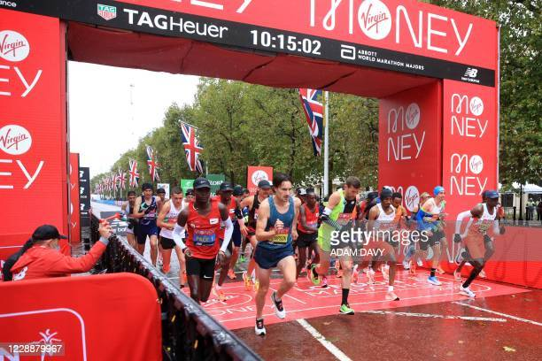 The start of the elite men's race of the 2020 London Marathon in central London on October 4, 2020. - This year's London marathon, an elite-athlete...