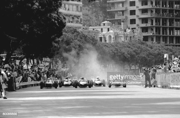 The start of the Monaco Grand Prix, Monte Carlo, 14th May 1961. The privately-entered Lotus of Stirling Moss, is on pole at the left with the Ferrari...