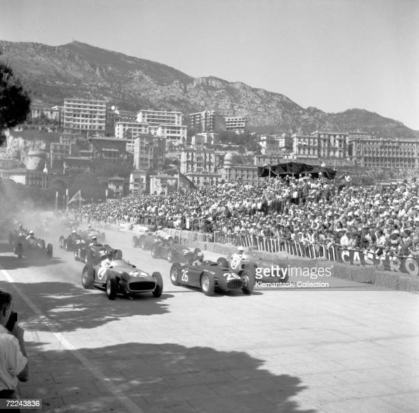 The start of the Monaco Grand Prix, Monte Carlo, 22nd May 1955. Juan Manuel Fangio and Stirling Moss in the Mercedes W196 bracket Alberto Ascari's...