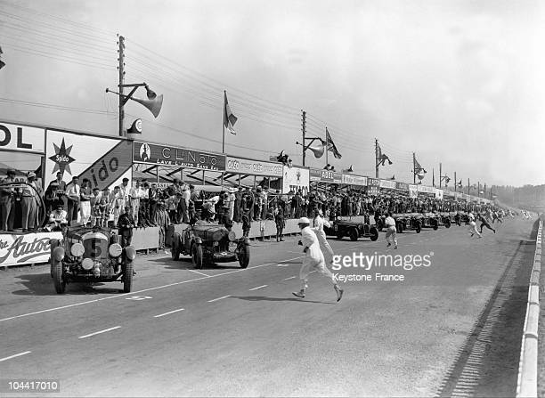 The start of the race is given and the riders rushed to their car at the 24 Hours of Le Mans in 1932