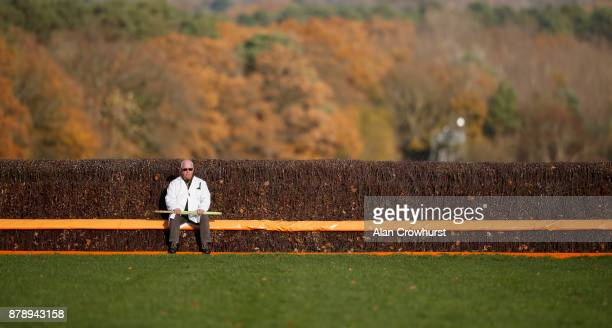 The start recall official waits for the runners to arrive at the start at Ascot racecourse on November 25 2017 in Ascot United Kingdom