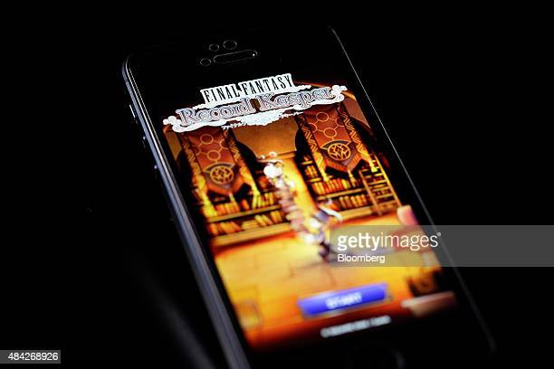 The start screen of the Final Fantasy Record Keeper smartphone game codeveloped by Square Enix Co and DeNA Co is displayed on an Apple Inc iPhone 5...